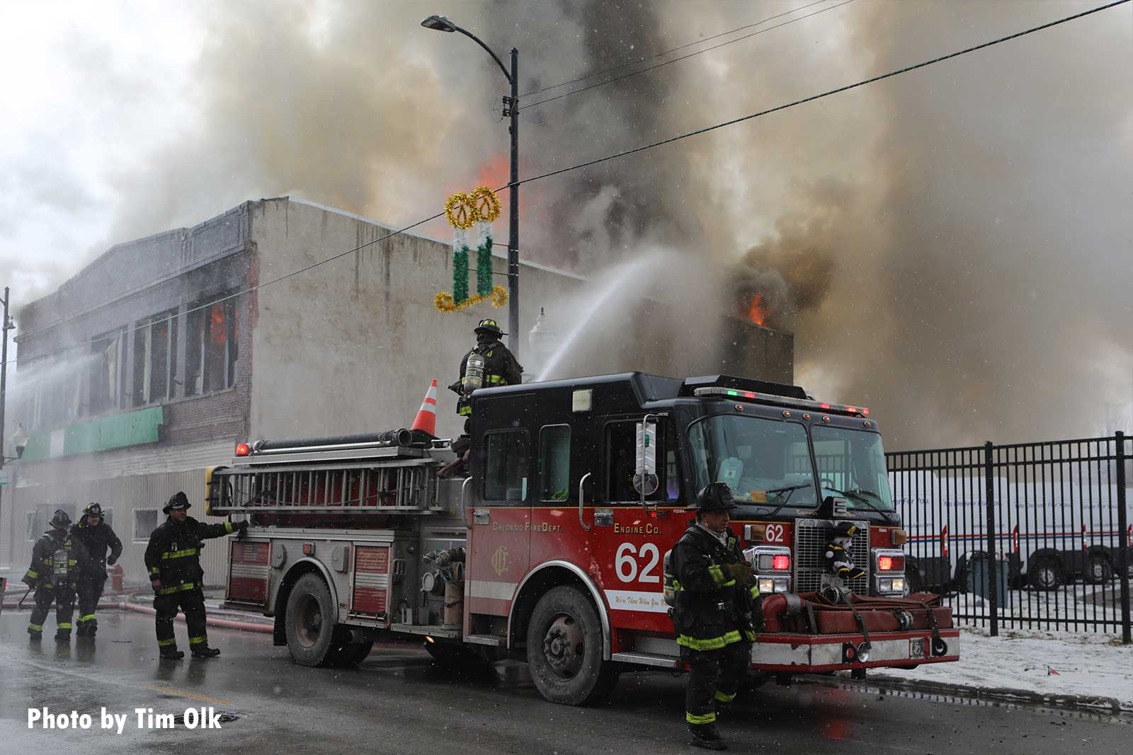 Chicago fire apparatus with firefighter using a deck gun