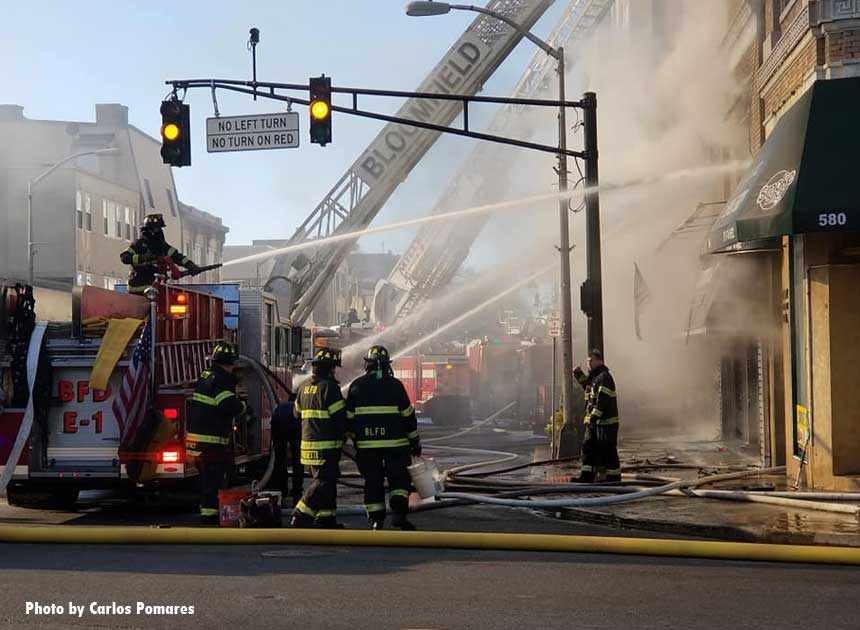 Firefighters and aerial apparatus on the fireground