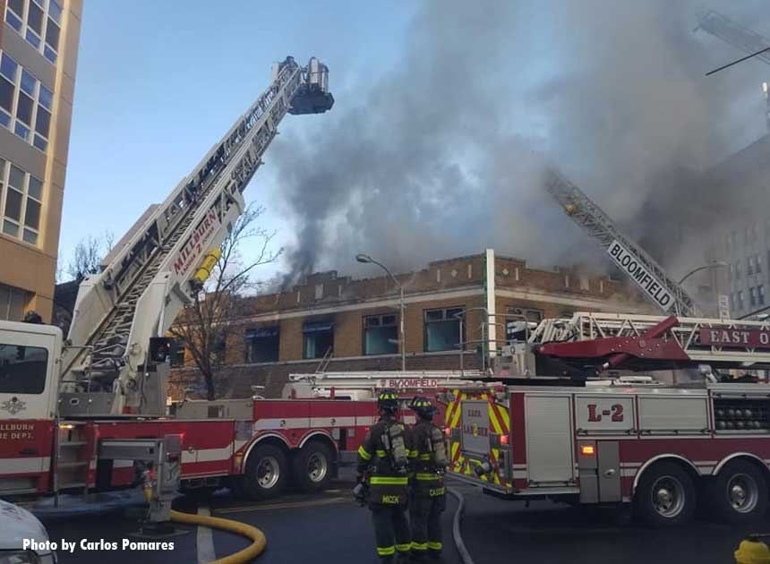 An array of apparatus at a fire in a building housing several business in Bloomfield, New Jersey.