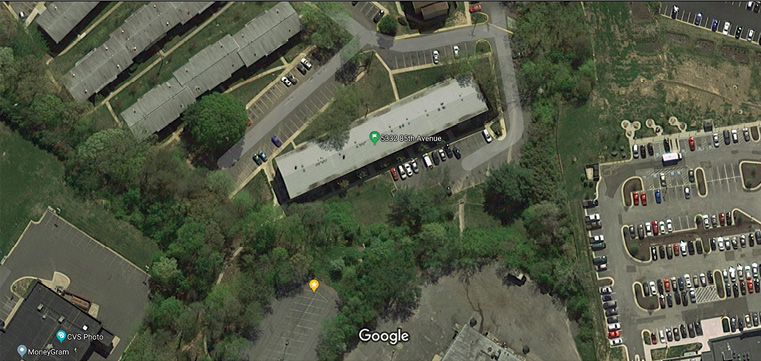 An overview of an apartment complex in Prince George's County, Maryland. The green marker indicates the call location. The yellow marker is the truck apparatus's position. Using the adjacent shopping center parking lot, the officer guided the truck driver to the building's side A. Using mapping technology, they spotted a way to gain access. (Imagery ©2019 Google, Imagery ©2019 Commonwealth of Virginia, Maxar Technologies, Sanborn, U.S. Geological Survey, Map data ©2019)
