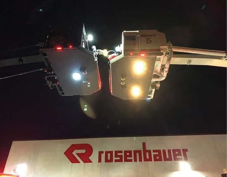 Even when equipped with lights, a black or dark colored aerial device has no contrast against the night sky. [Photos courtesy of the Wyndmoor (PA) Hose Company.]