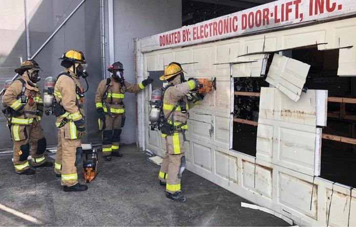 Firefighters cutting a garage door prop