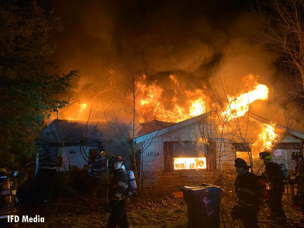 Indianapolis firefighters operate defensively at the house fire