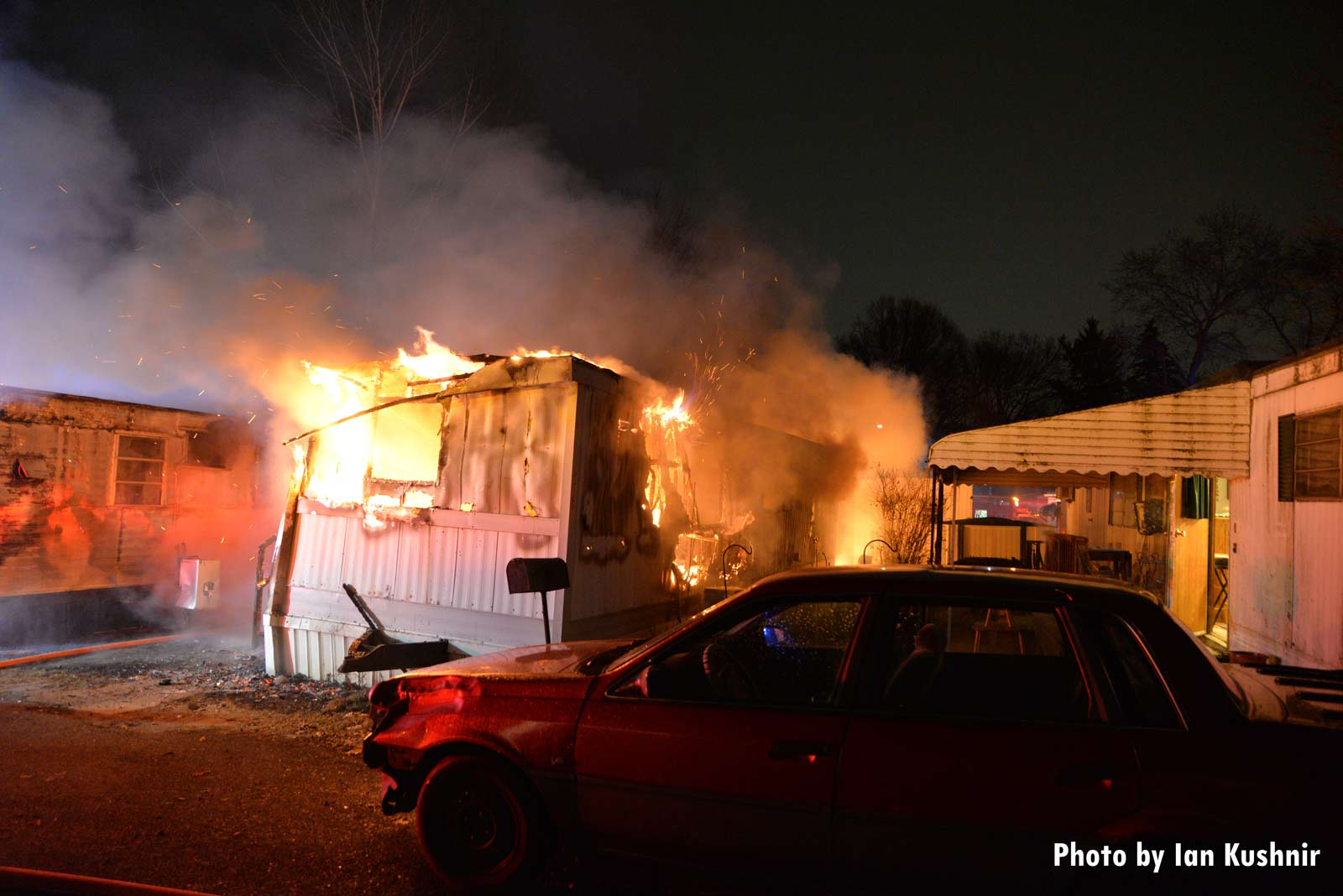 Flames shooting from a mobile home