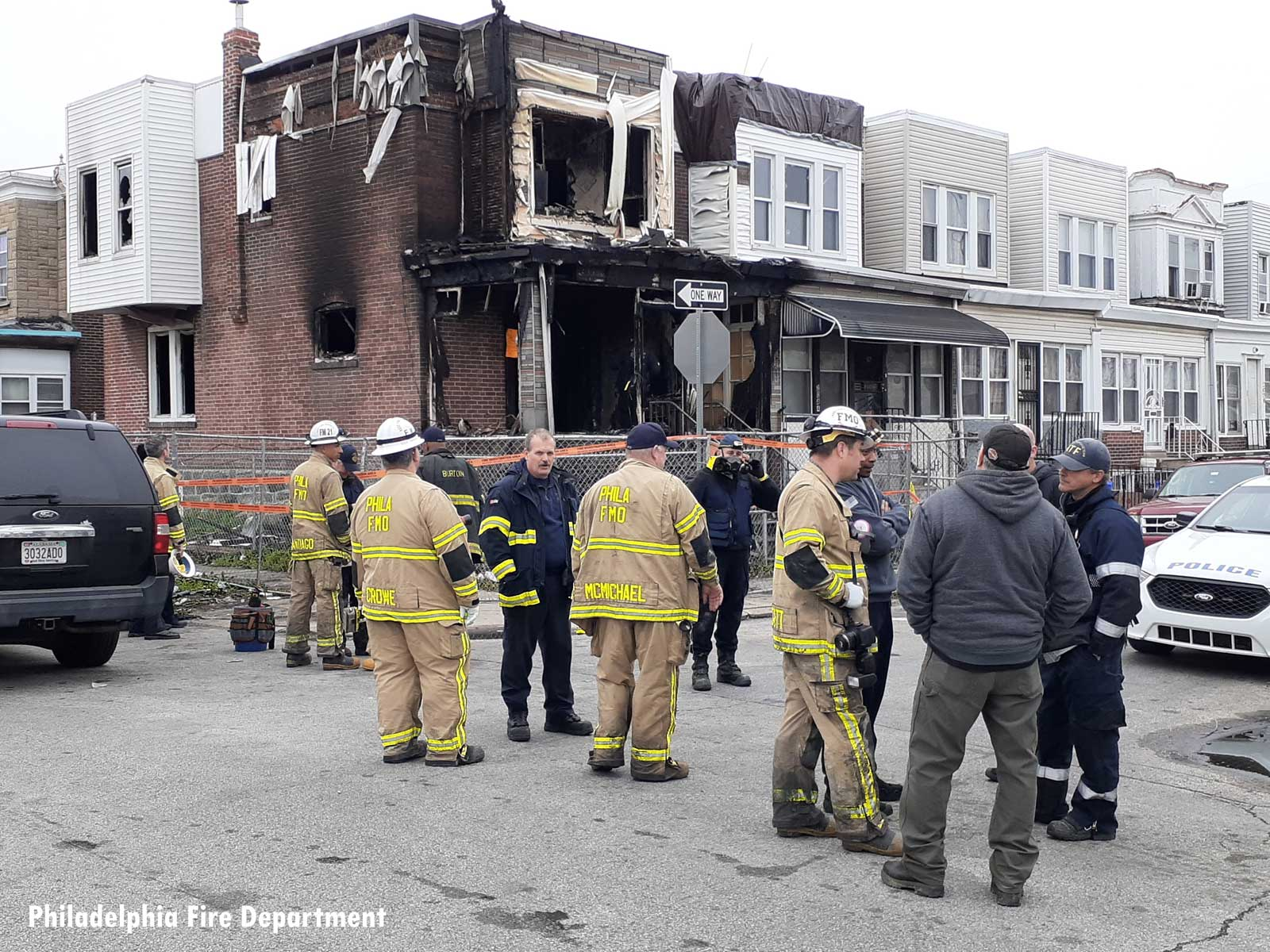 Philadelphia firefighters at the scene of a fatal fire