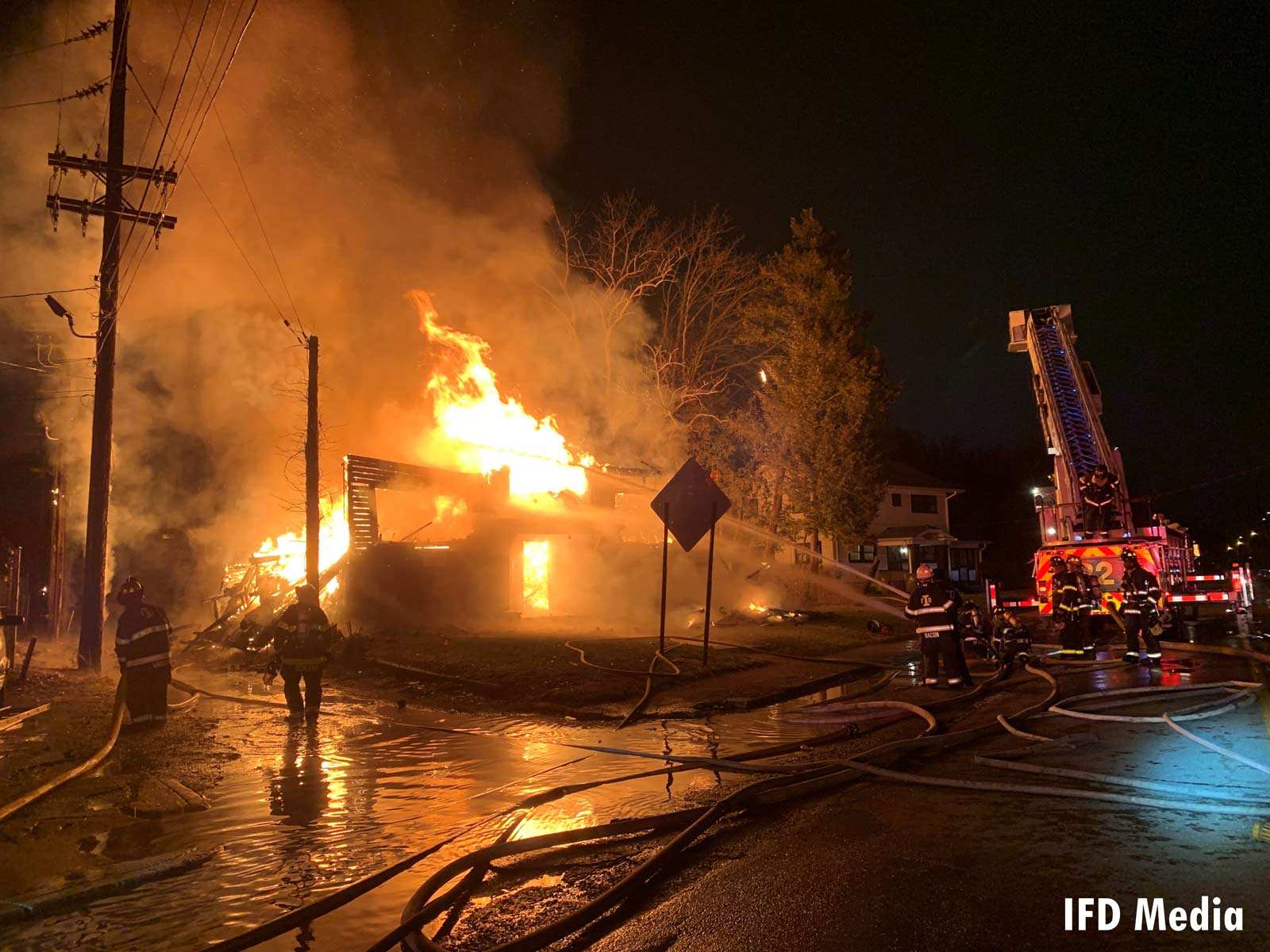 Indianapolis fire apparatus and firefighters battle a large fire