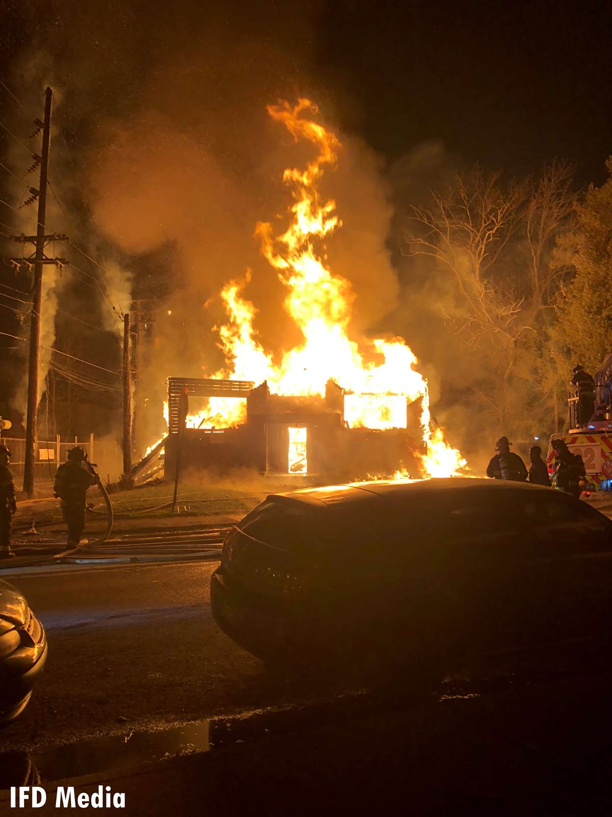 Indianapolis firefighter on scene of a raging fire