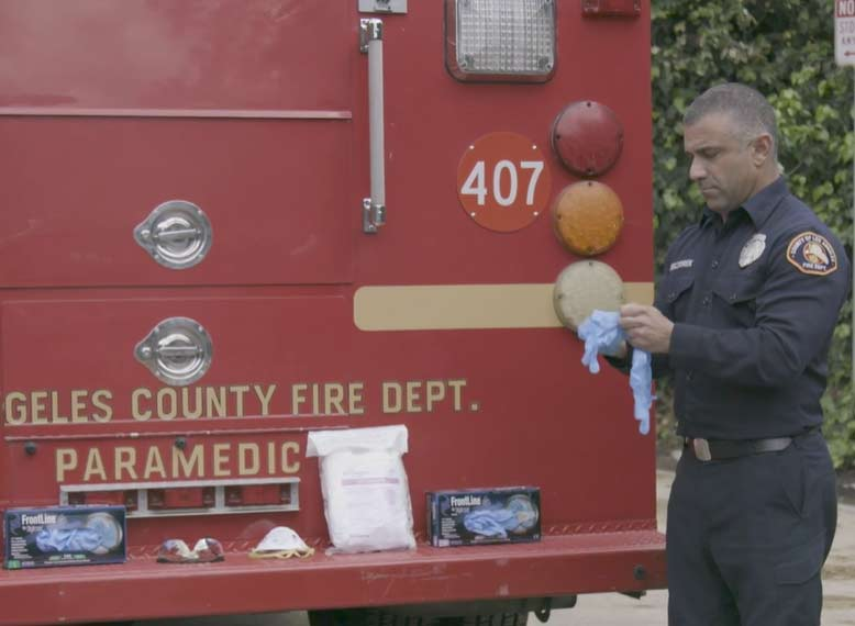 Los Angeles County medic donning gloves