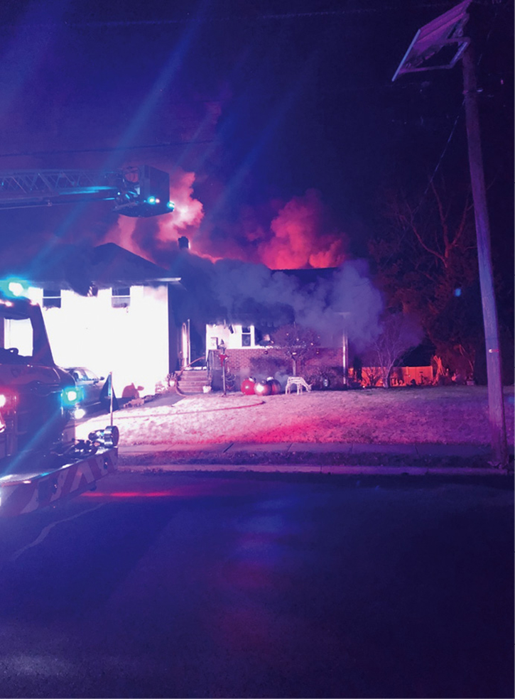 Initial conditions of the A side of the structure. Thick, black smoke is visible along the entire A side soffit, and a glow can be seen from the C side of the structure.