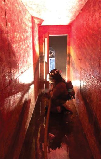 The heel firefighter moves the hose.