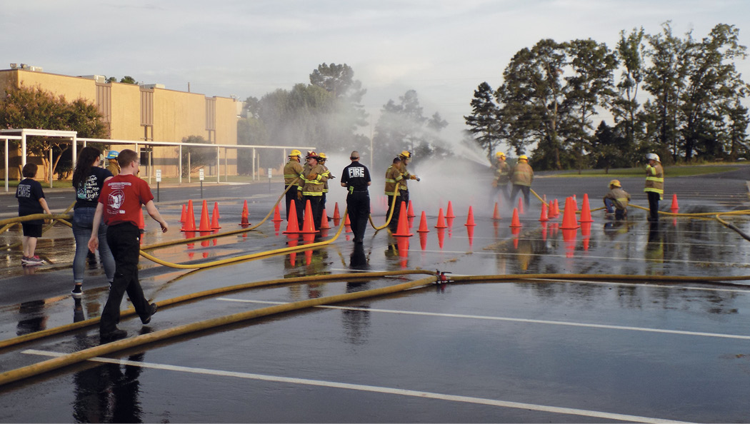 """""""Parking lot"""" hose and fire attack evolutions can prove to be valuable and effective when introducing rookie members to the art of hose handling and fire streams."""