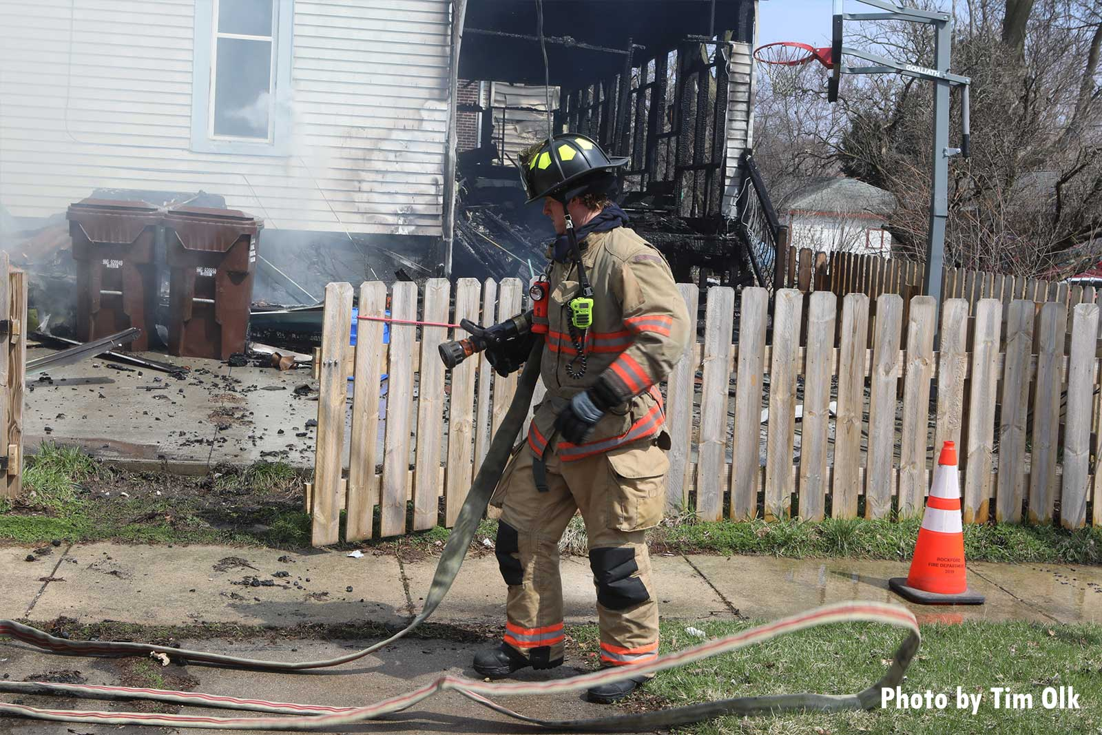 Firefighter with a hoseline at the fire scene