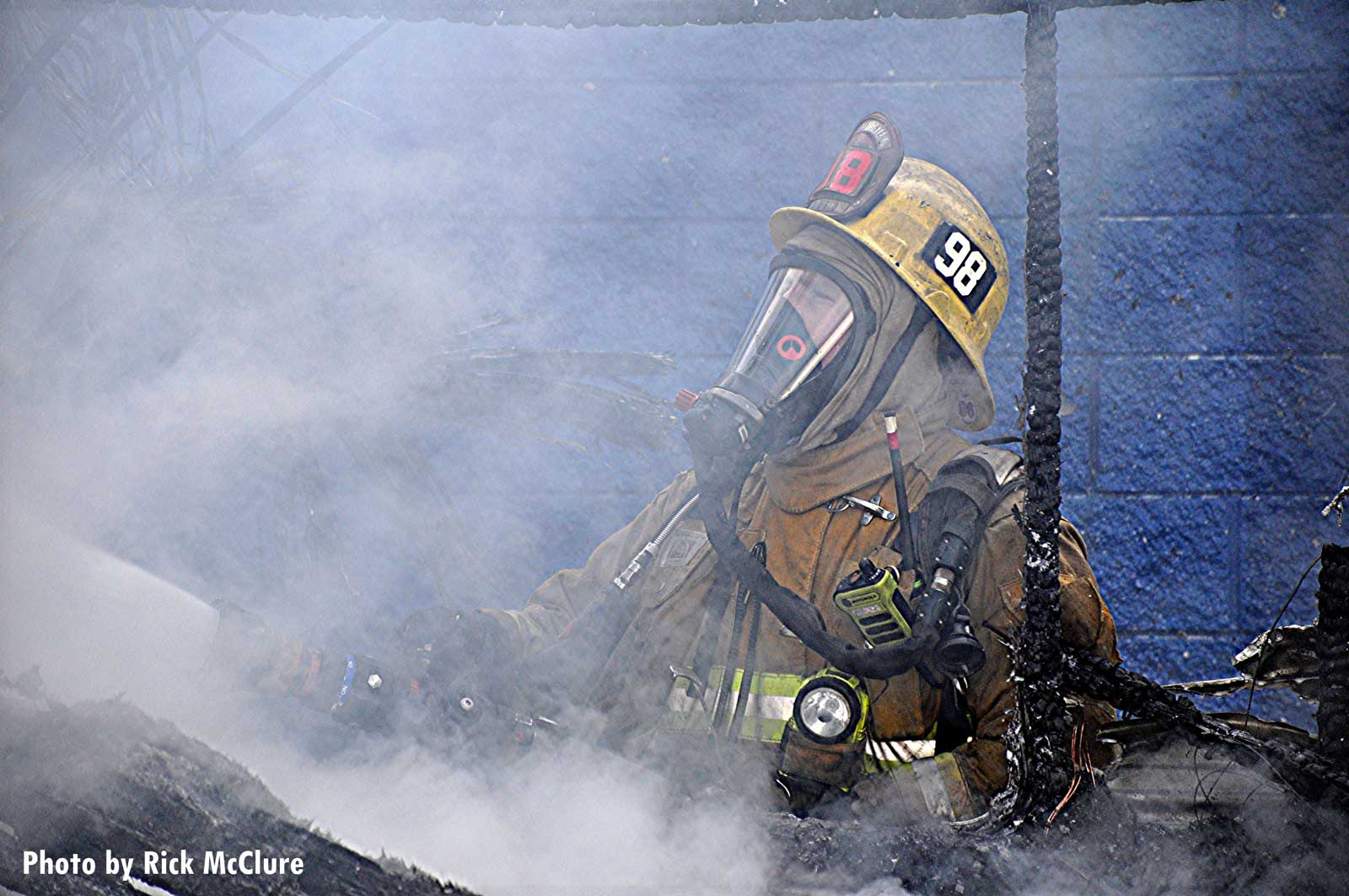 LAFD firefighter in full gear at trailer fire