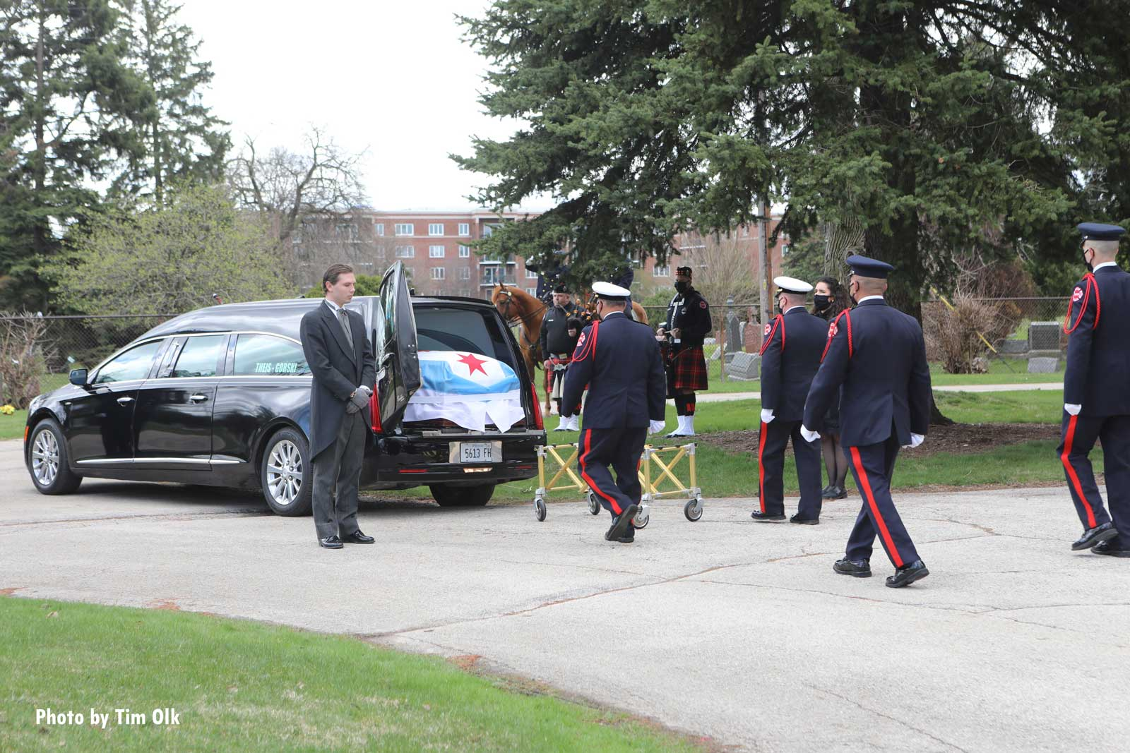 Chicago firefighters at the funeral of a member who died from COVID-19 complications