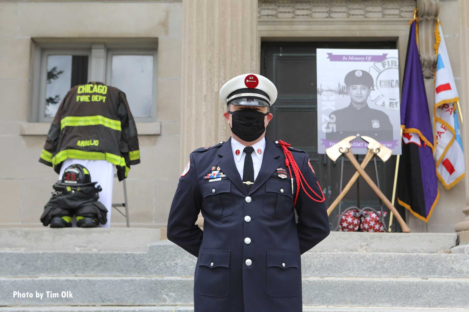 A photo of Araujo, ceremonial axs, and his turnout gear