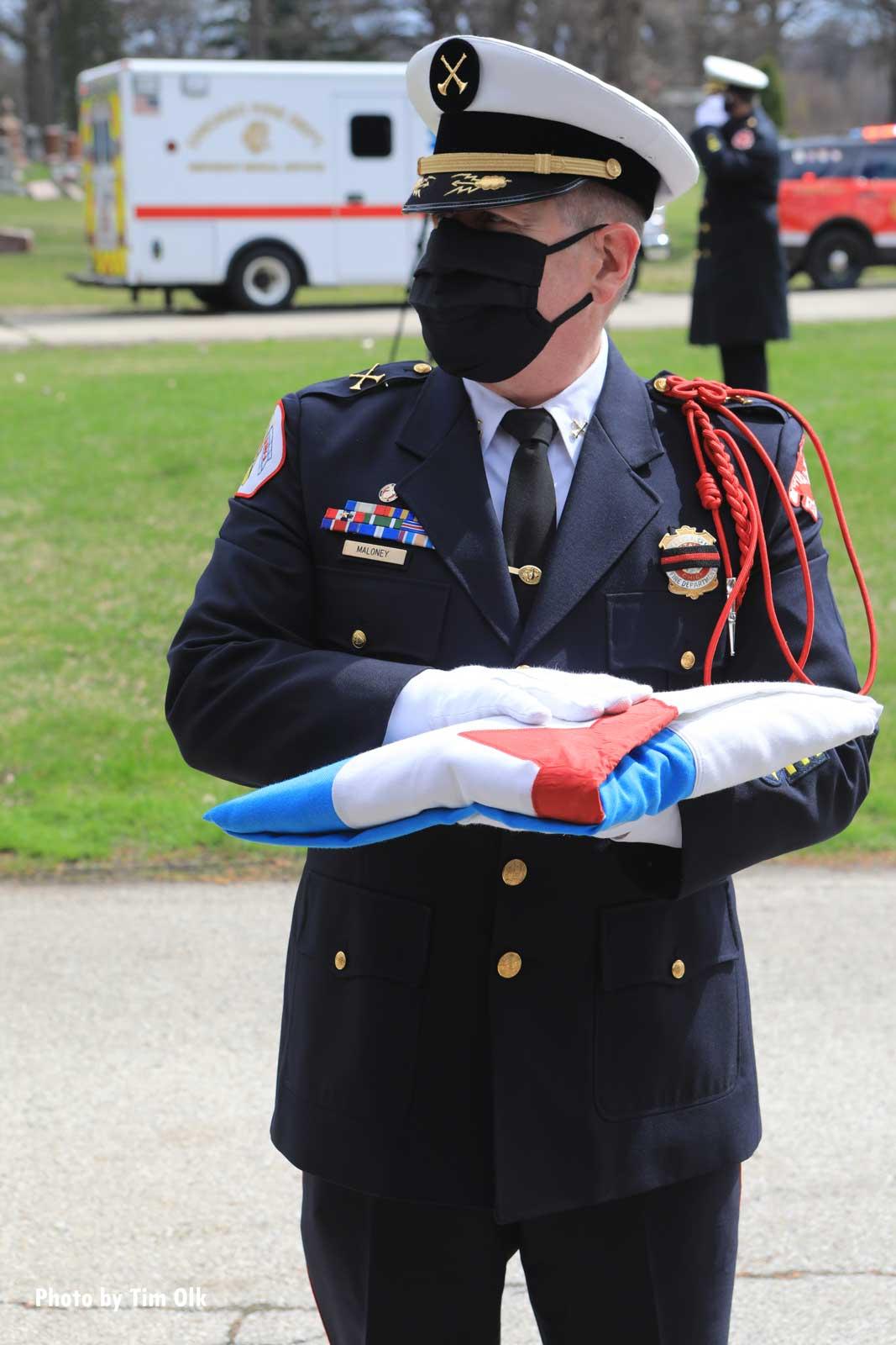 Firefighter bearing a flag