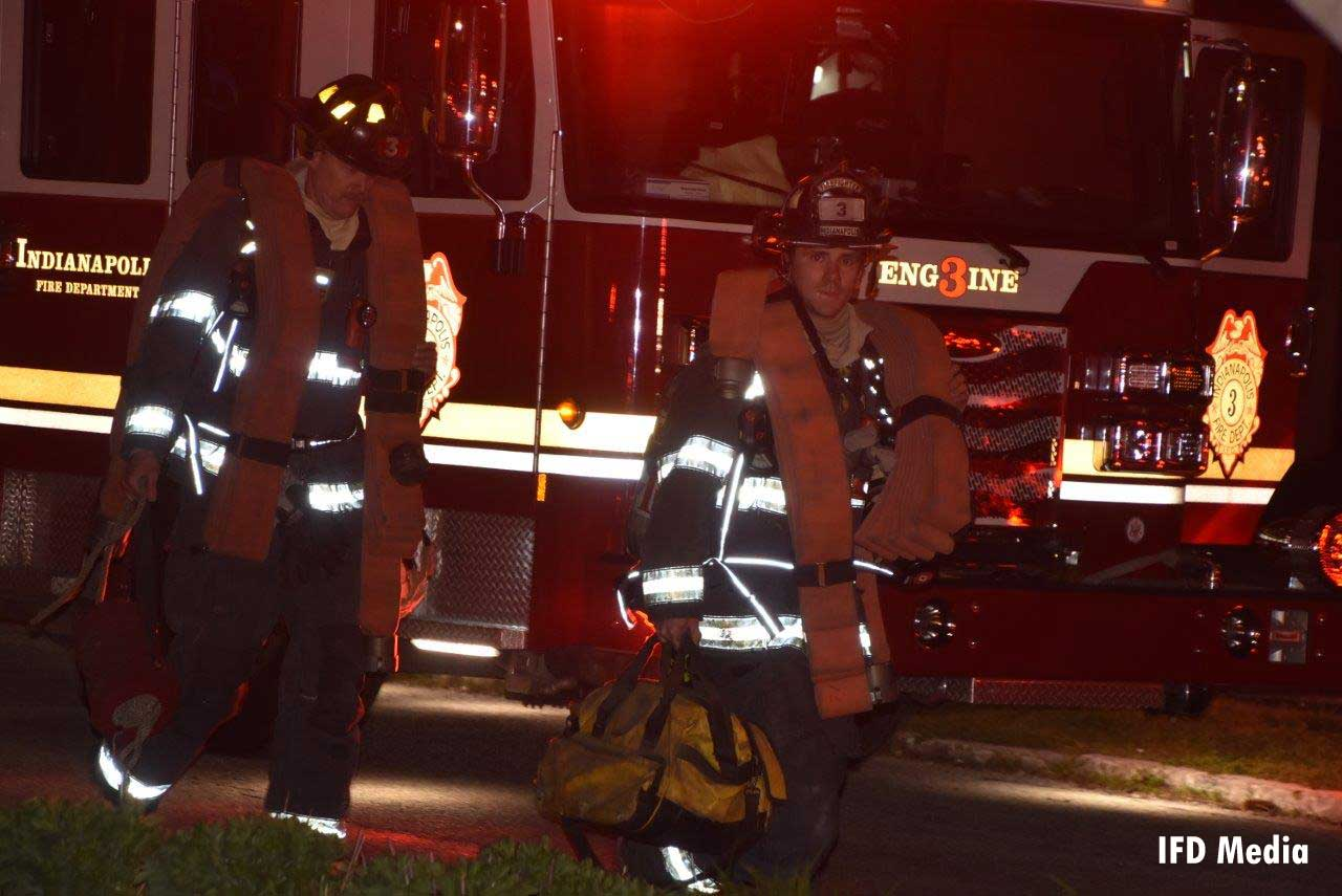 Indianapolis firefighters operating at apartment fire