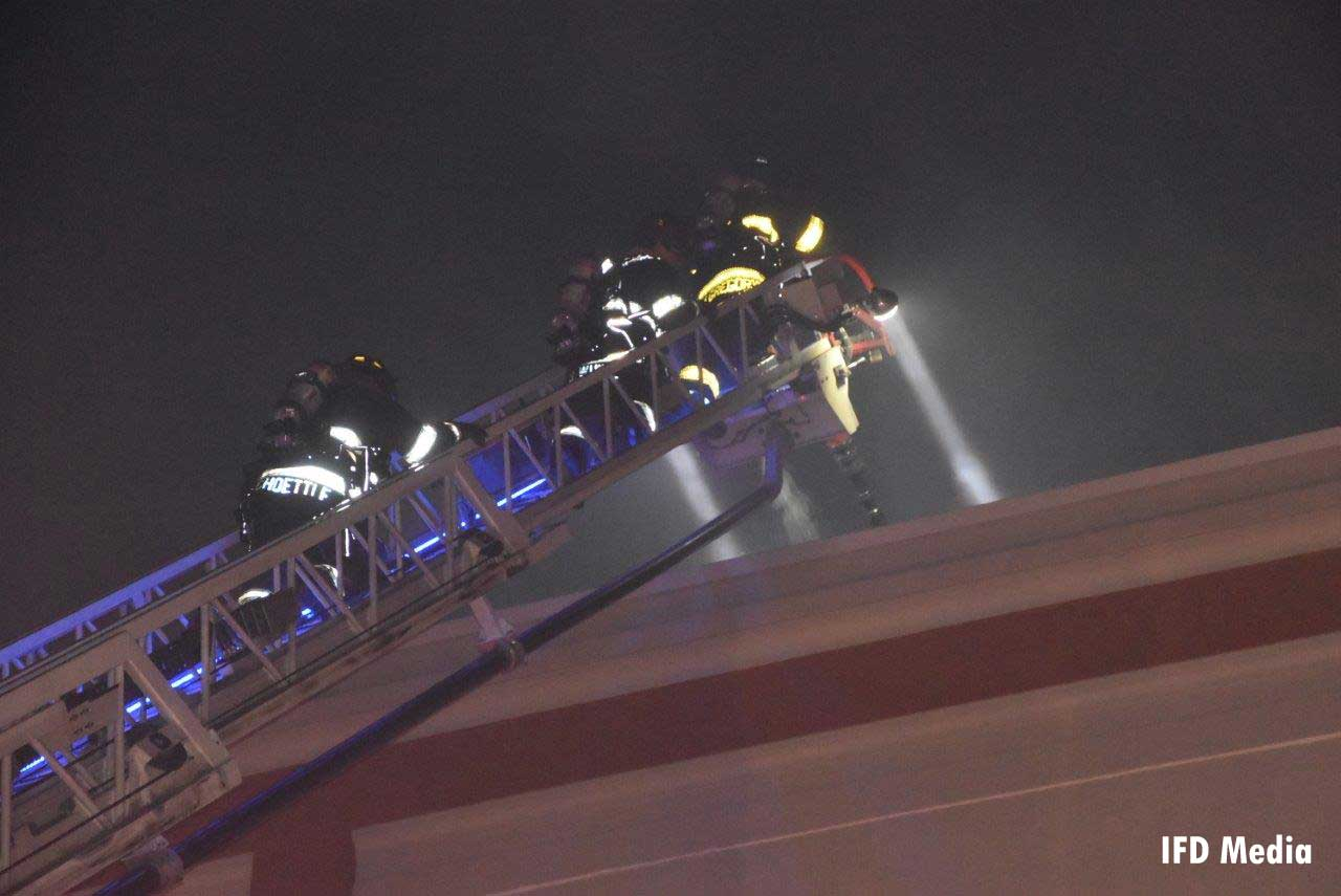 Firefighters on aerial ladder