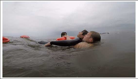 A surf rescue technician uses the cross-chest-carry with a Burnside RFD