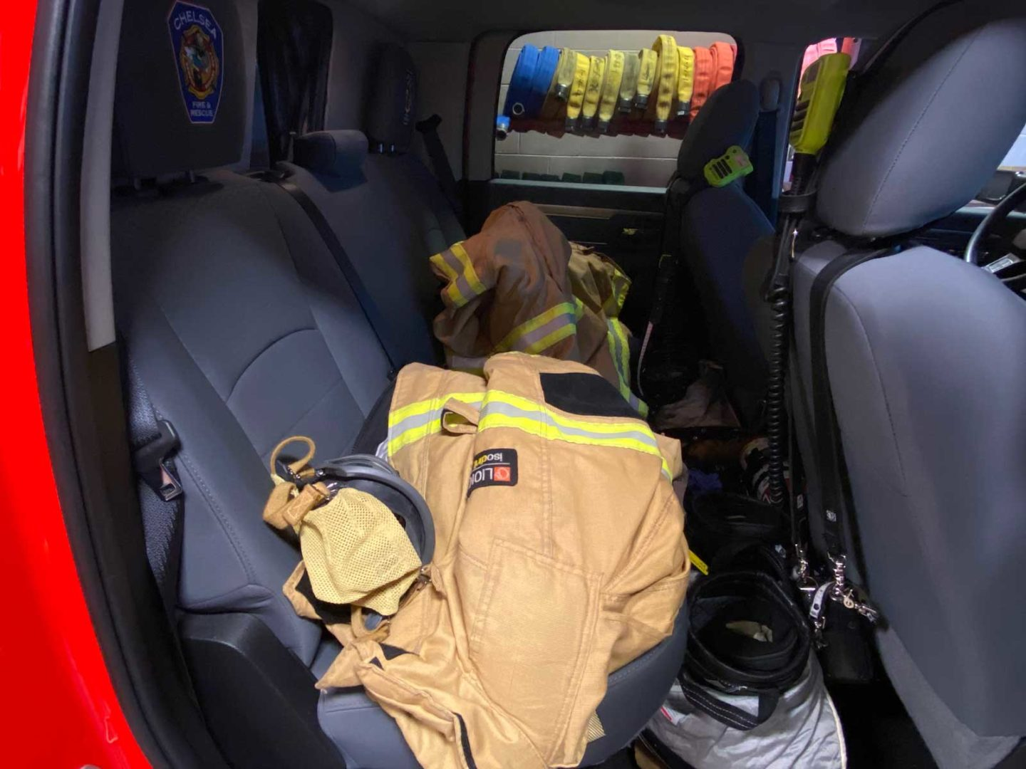 Firefighter PPE ion the seats of a fire truck