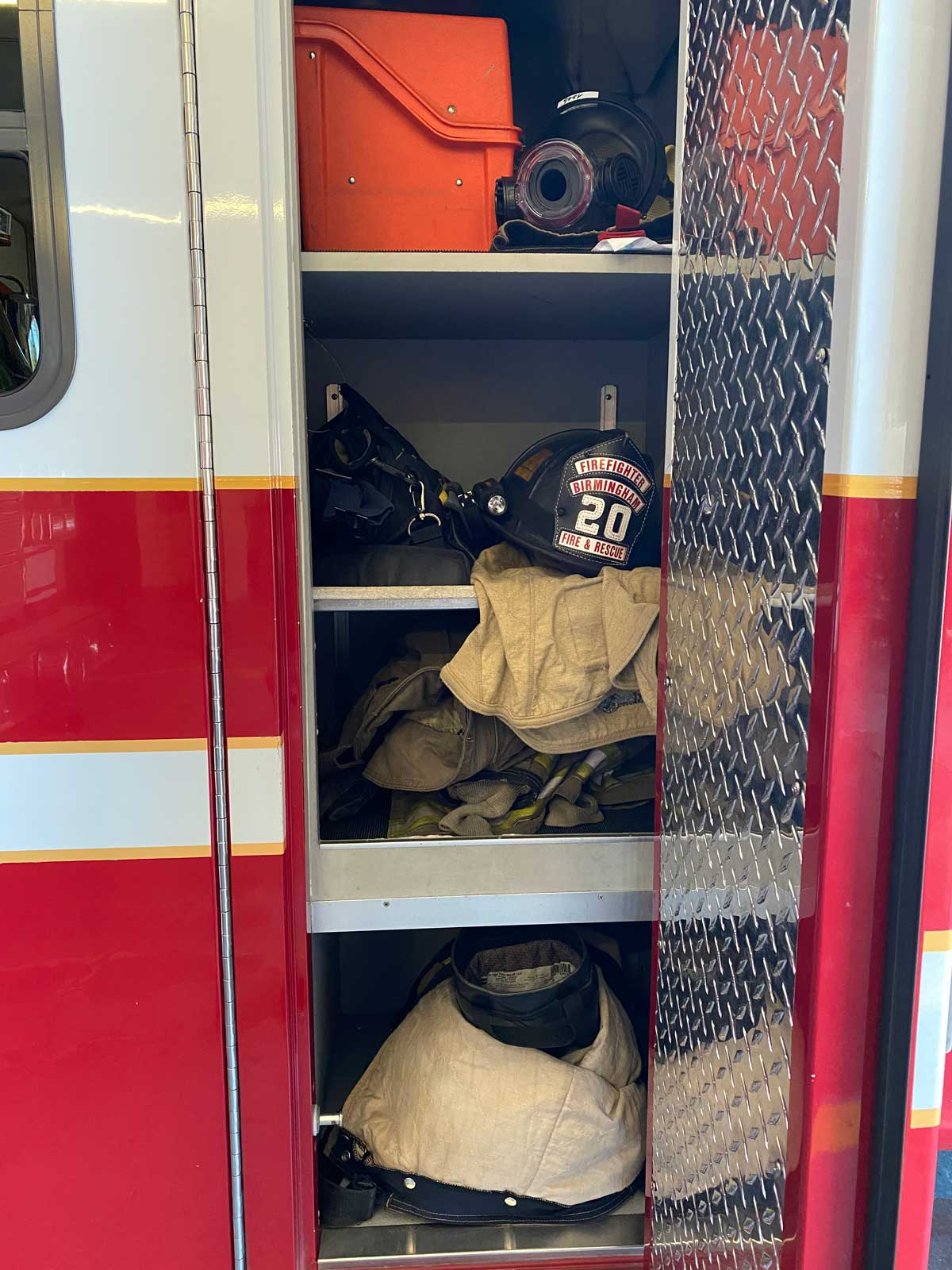 A compartment on a fire apparatus containing firefighting gear