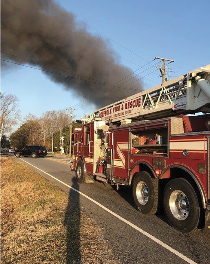 A motorist notified 911 when he saw a large smoke column in the area. Because of the distance off the road, first-arriving units were unsure of what was on fire until they made their way down a long dirt road.