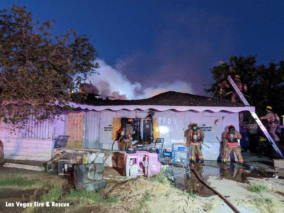 Firefighters operating at the scene of a vacant house fire in Las Vegas, Nevada.