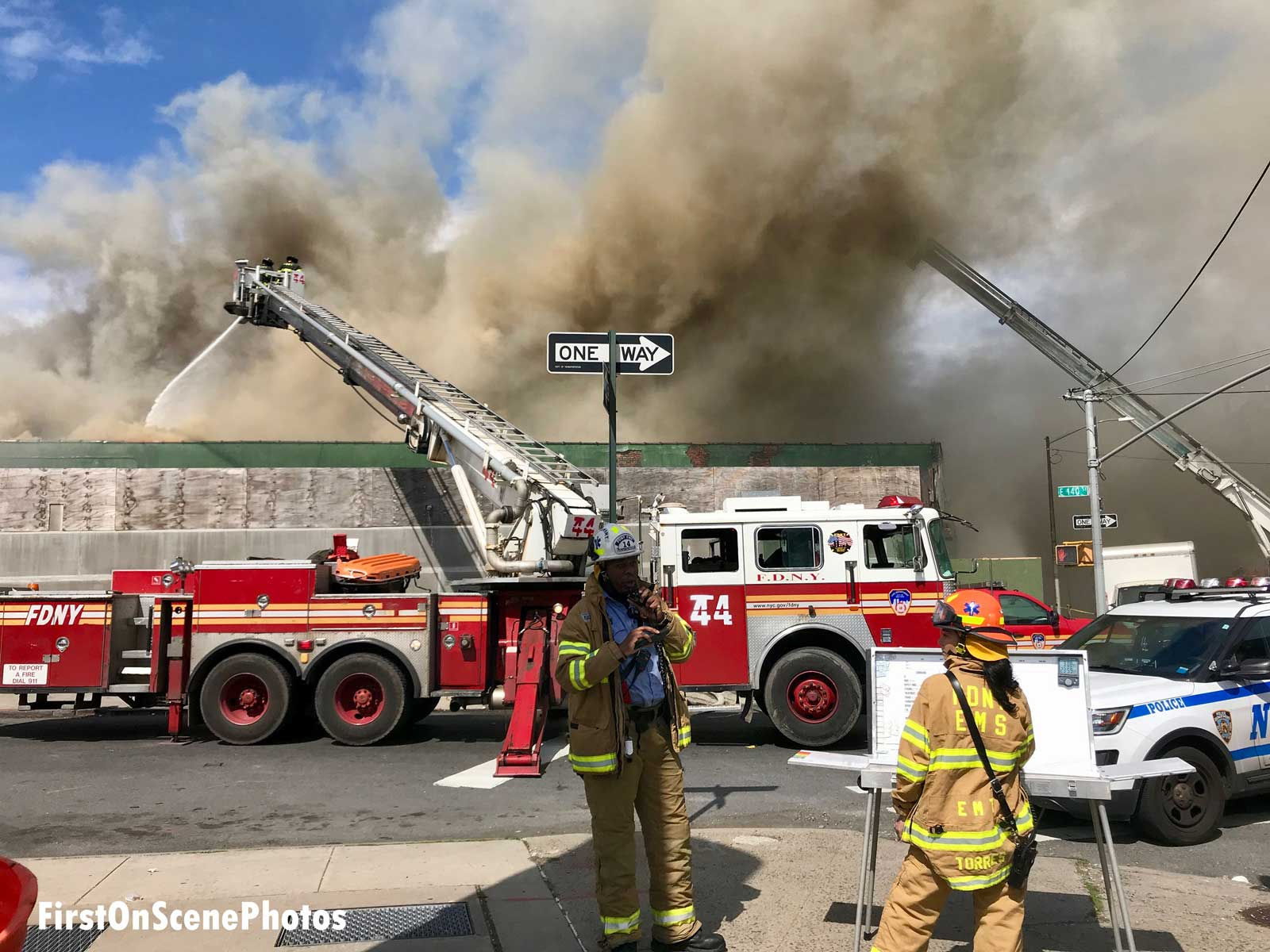 FDNY fire truck with aerial devices in operation at a Bronx warehouse fire
