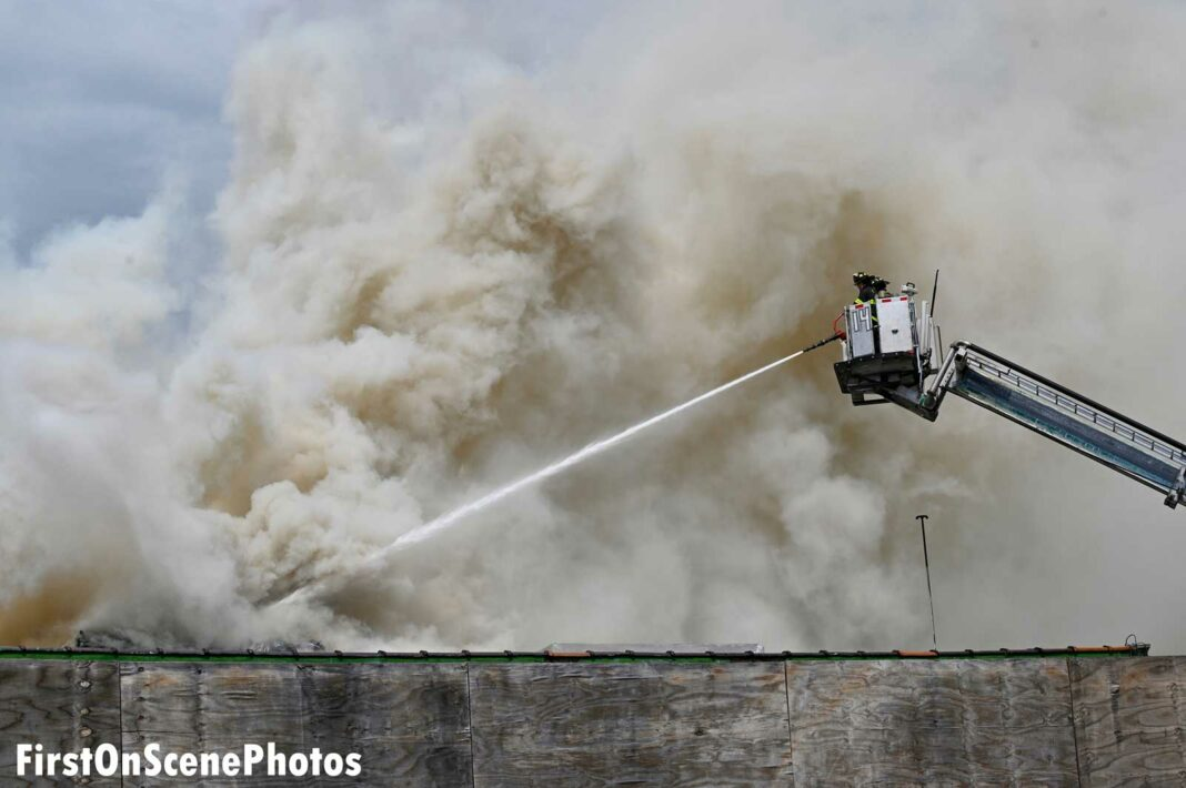 Master stream directed from a bucket at this fire in the Bronx