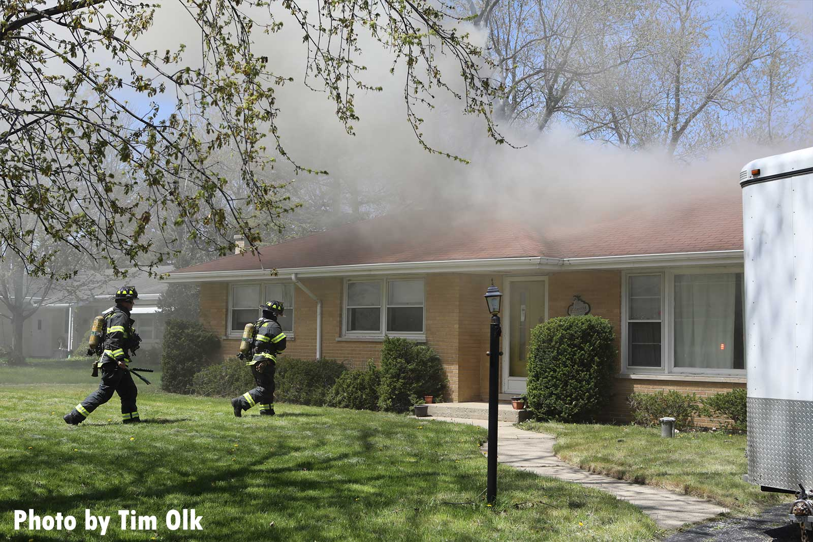 Firefighters arrive on scene with smoke showing from home