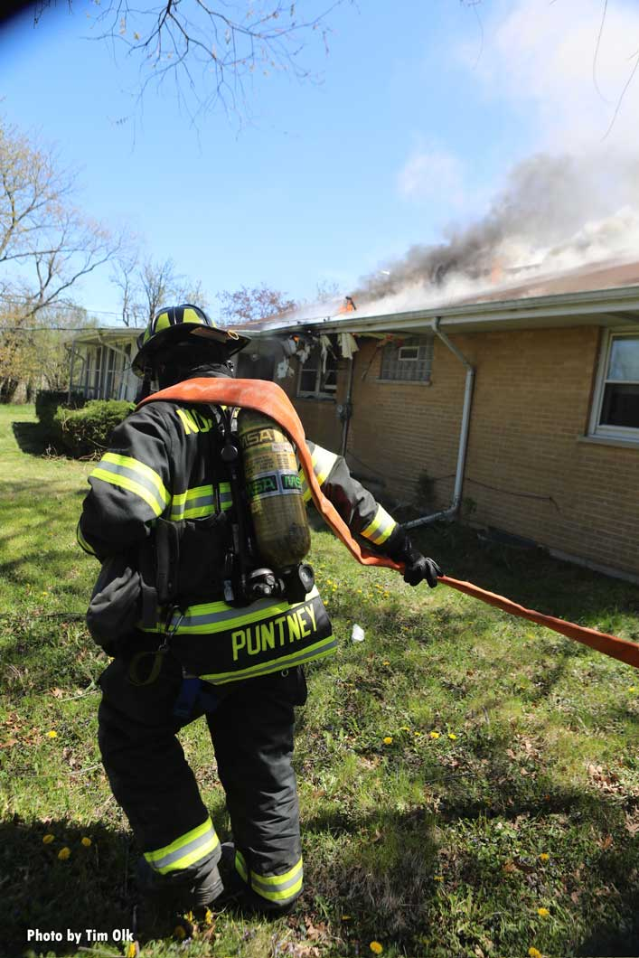 A firefighter flakes out a hoseline