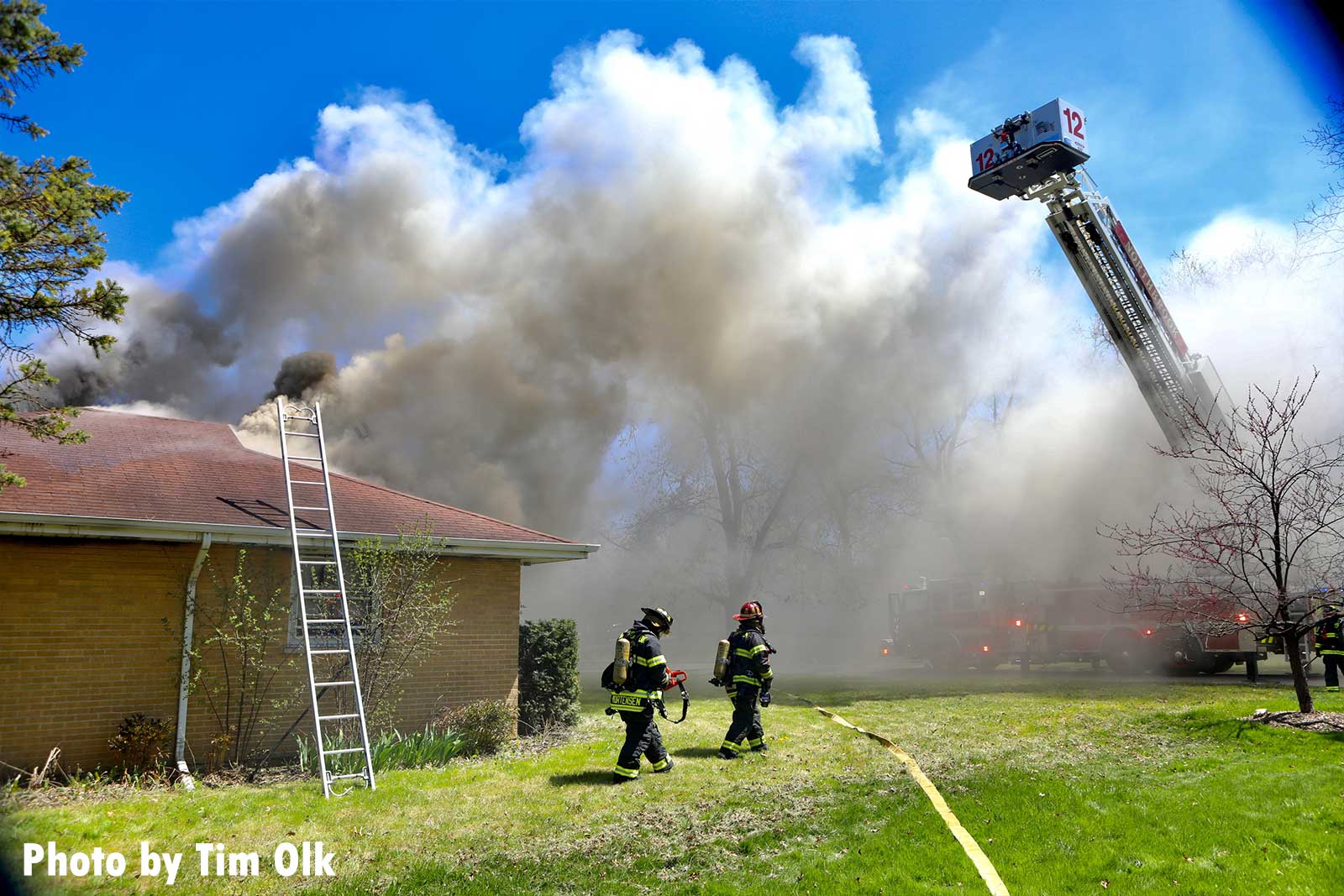 Ladders are raised and a tower ladder is seen