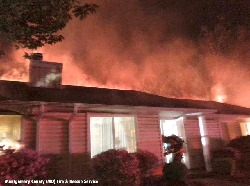Firefighter makes entry during a duplex fire