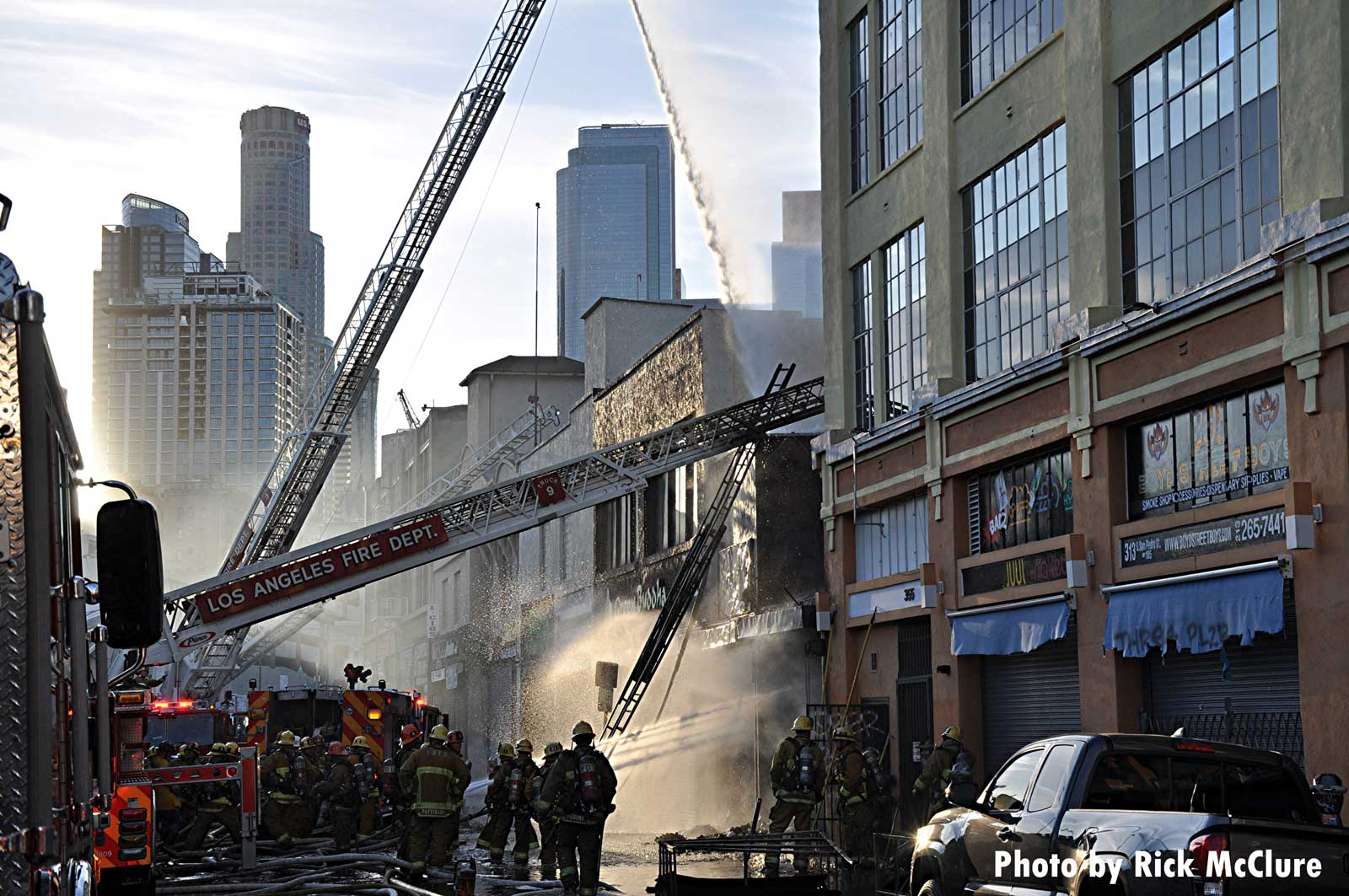 City of Los Angeles fire apparatus and firefighters at the scene of the explosion