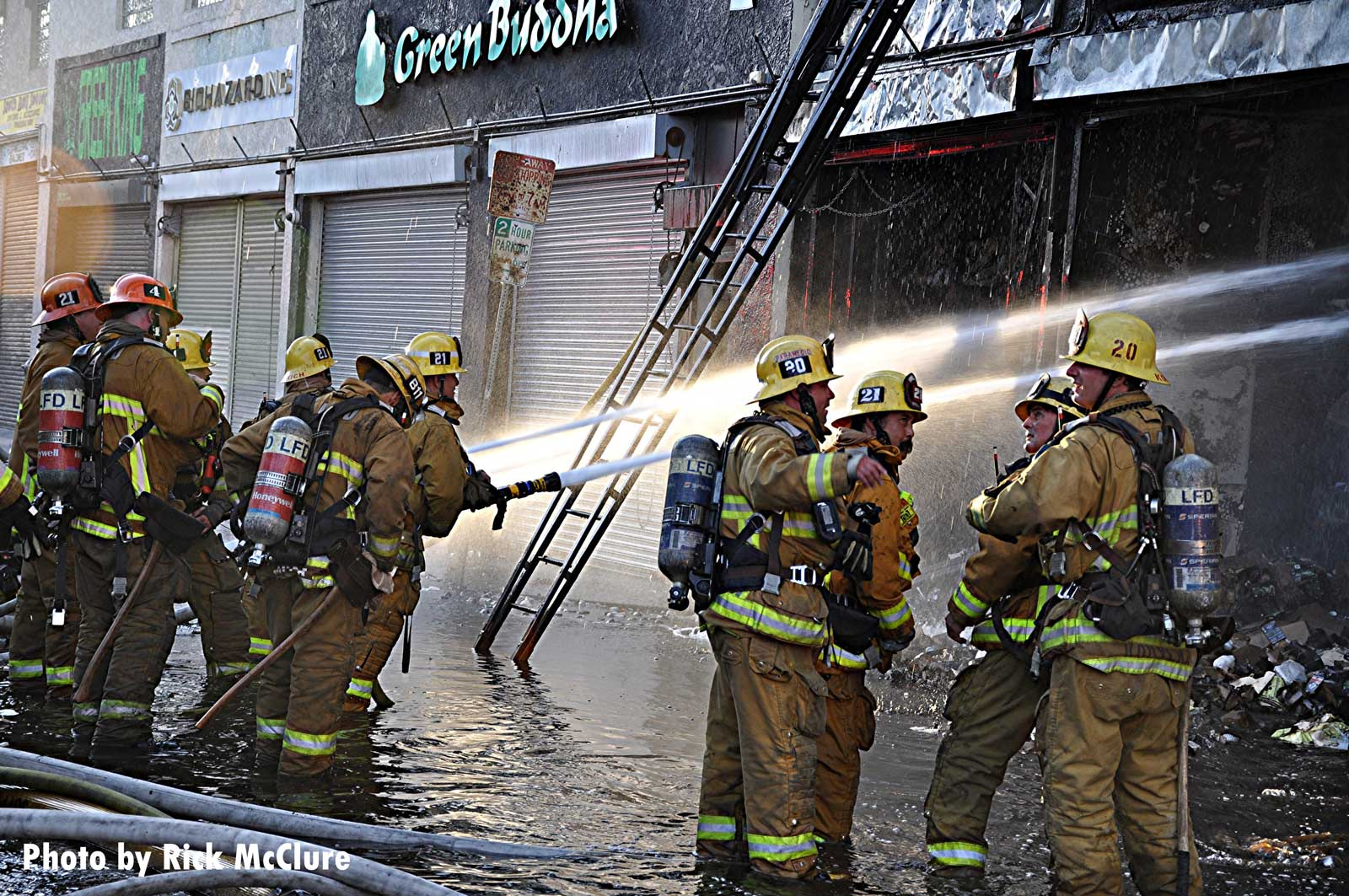 Firefighters put water on the fire in Los Angeles