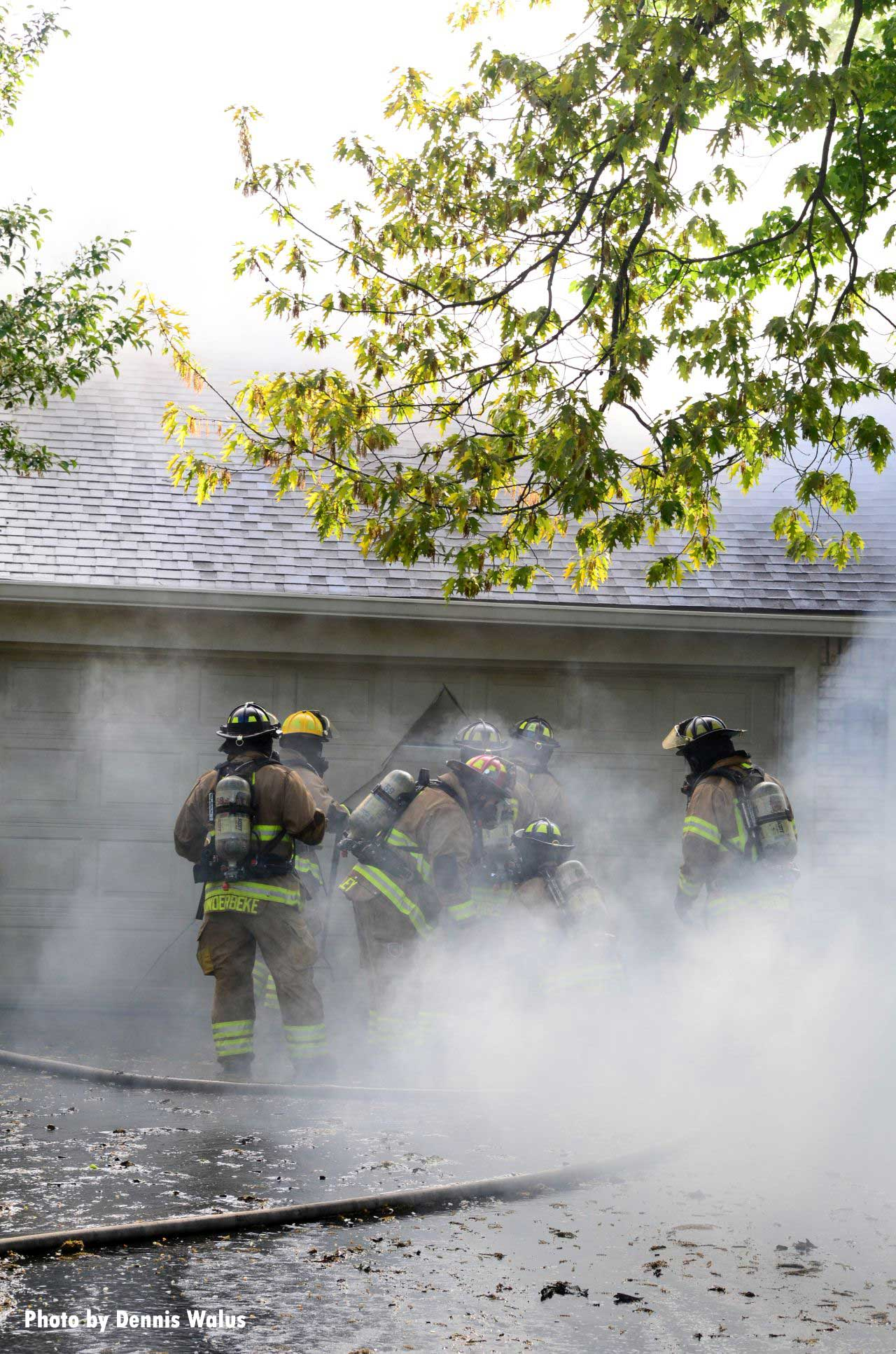 Firefighters surrounded in smoke