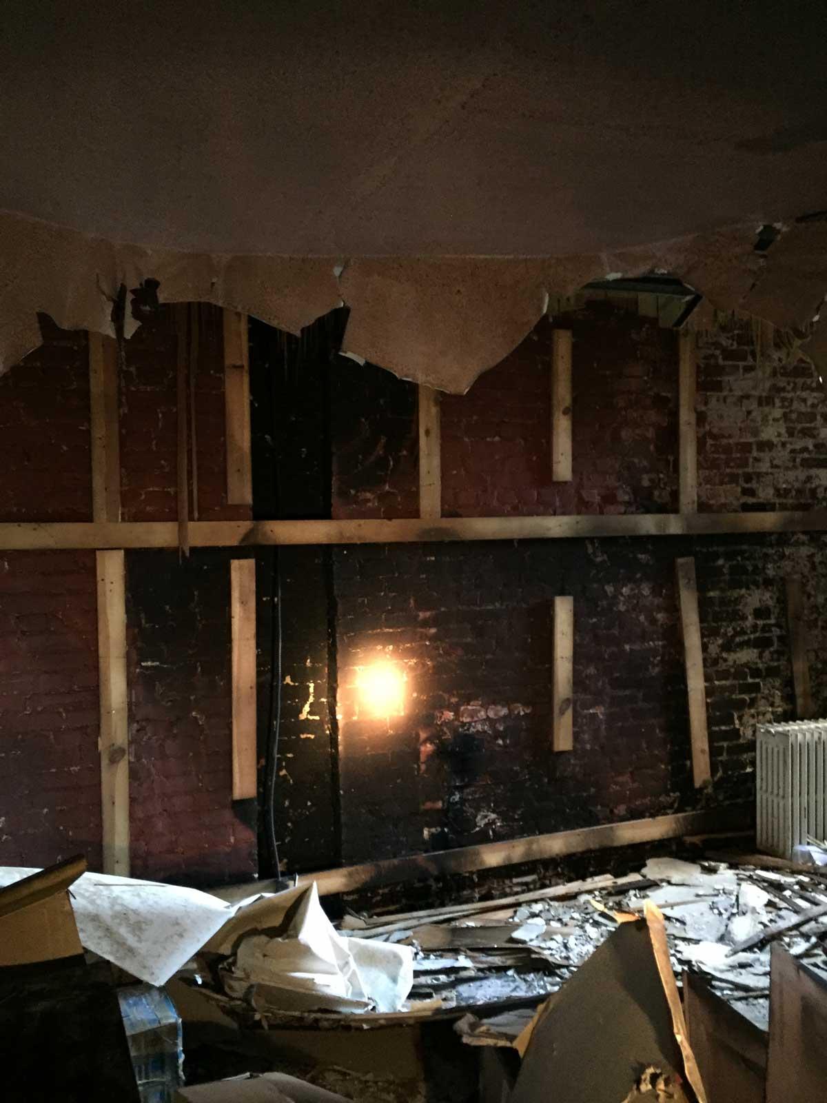 Interior brick firewall