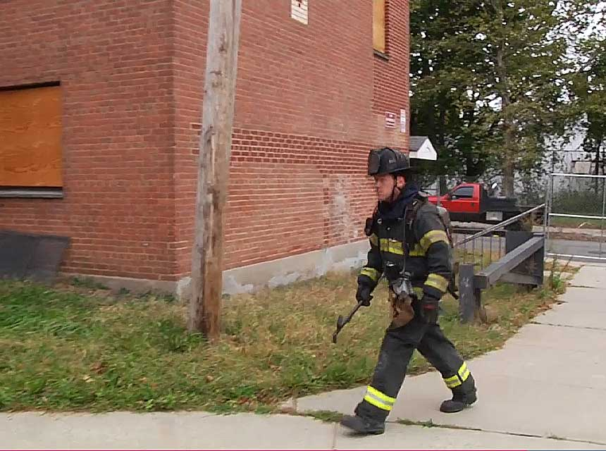 Outside vent firefighter goes around to the C side of the building