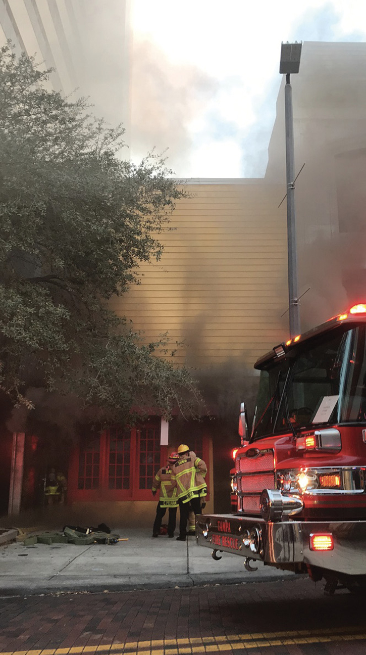 Smoke conditions five minutes after arrival. Compared to photo 2, these conditions had greatly decreased and continued to change repeatedly until the fire eventually broke through the roof.