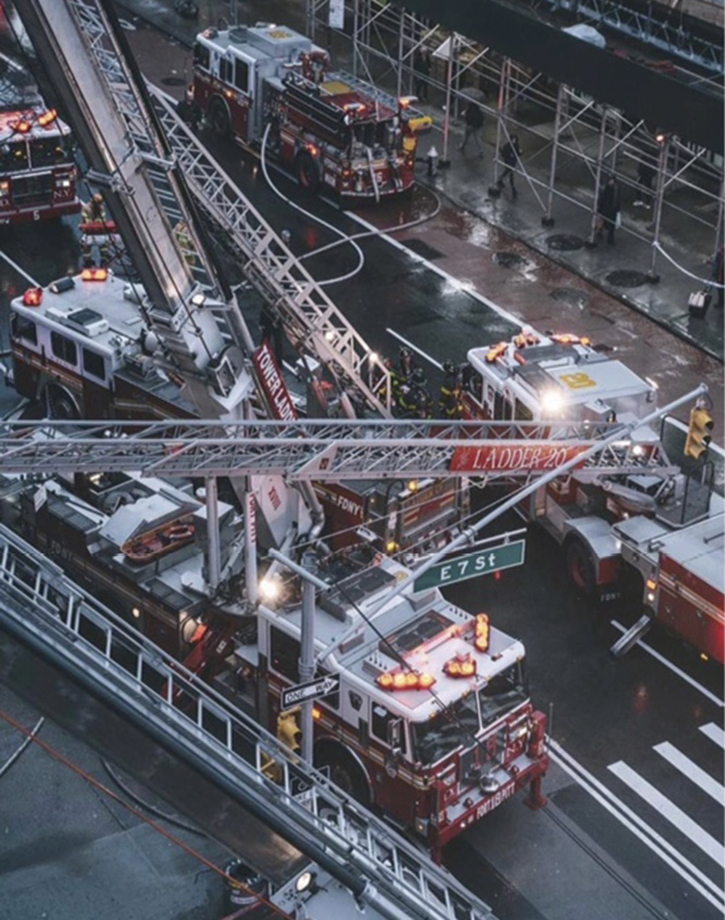Three aerials—one tiller and two tower ladders—operated at this scene and were used for ventilation, access, egress, and hose stretching.