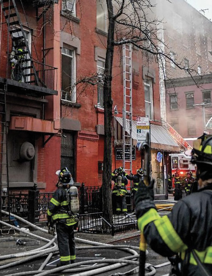 Ground ladders were positioned to provide firefighter egress as fire conditions intensified.