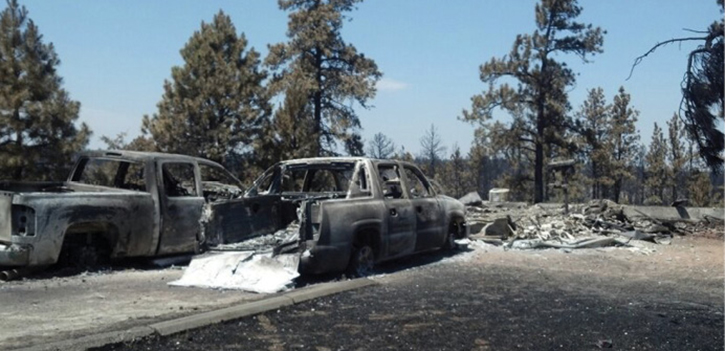 A residence and vehicles destroyed in a fast-moving WUI fire. Firefighters were unable to provide protection because they were unable to remain there safely.