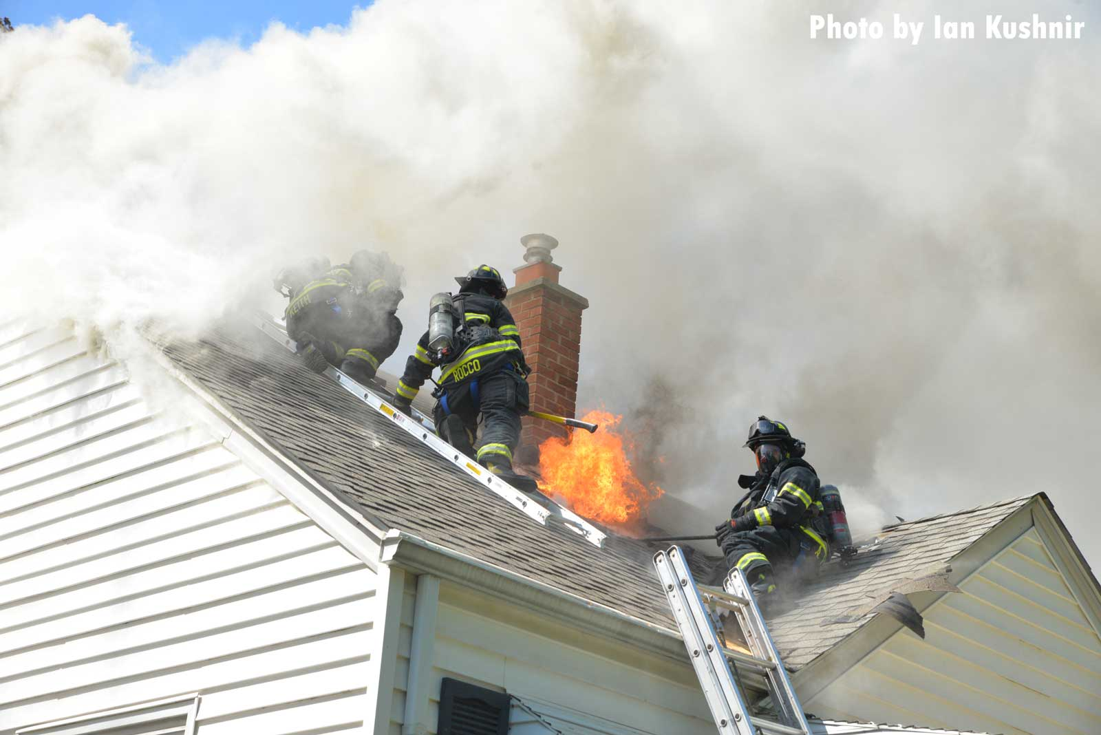 Flames shoot through the roof of the home