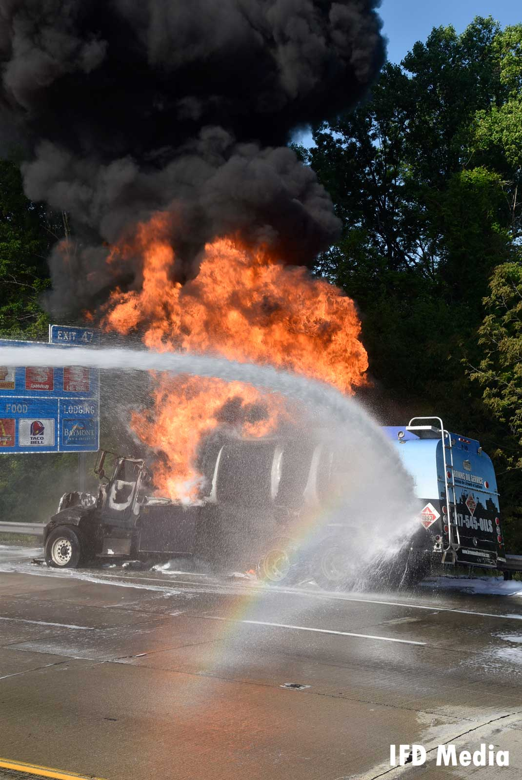 Water stream trained on burning truck