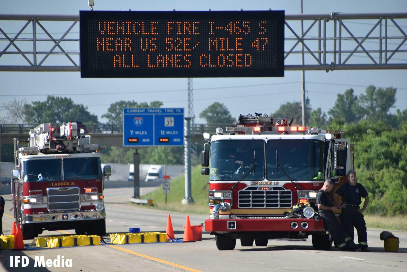 Fire trucks block the highway