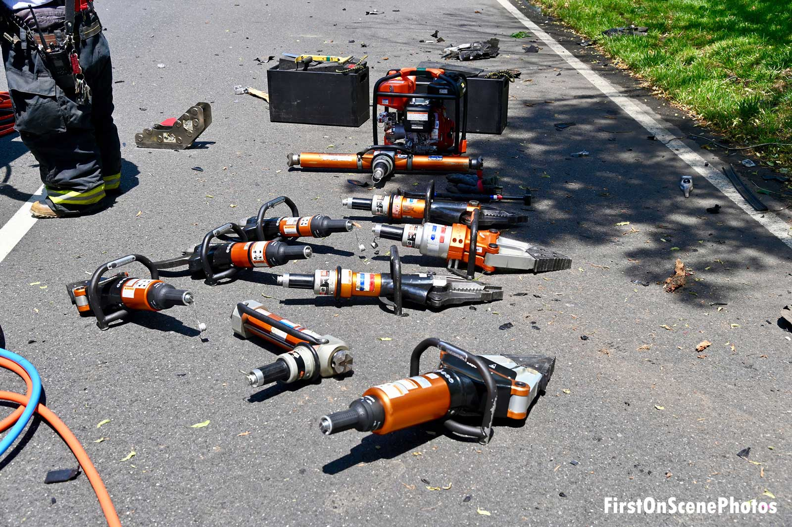 An array of extrication tools at the scene of the motor vehicle accident