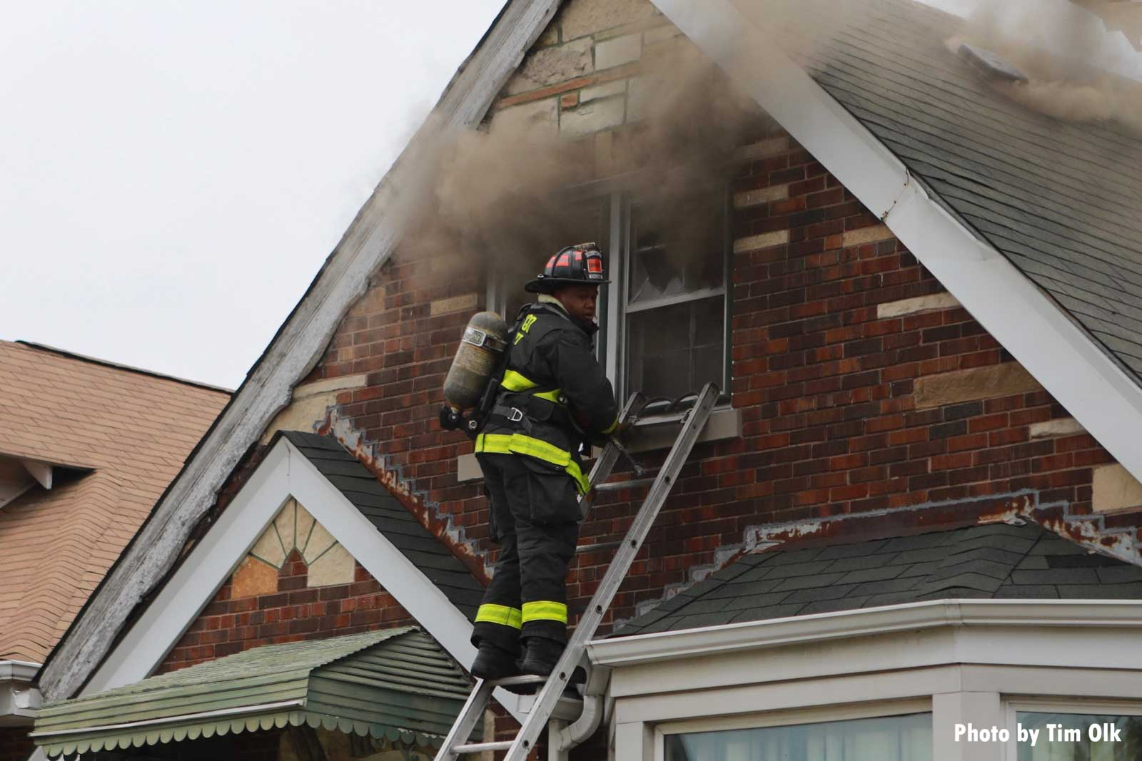 Chicago firefighter on a ladder at the window with smoke condition