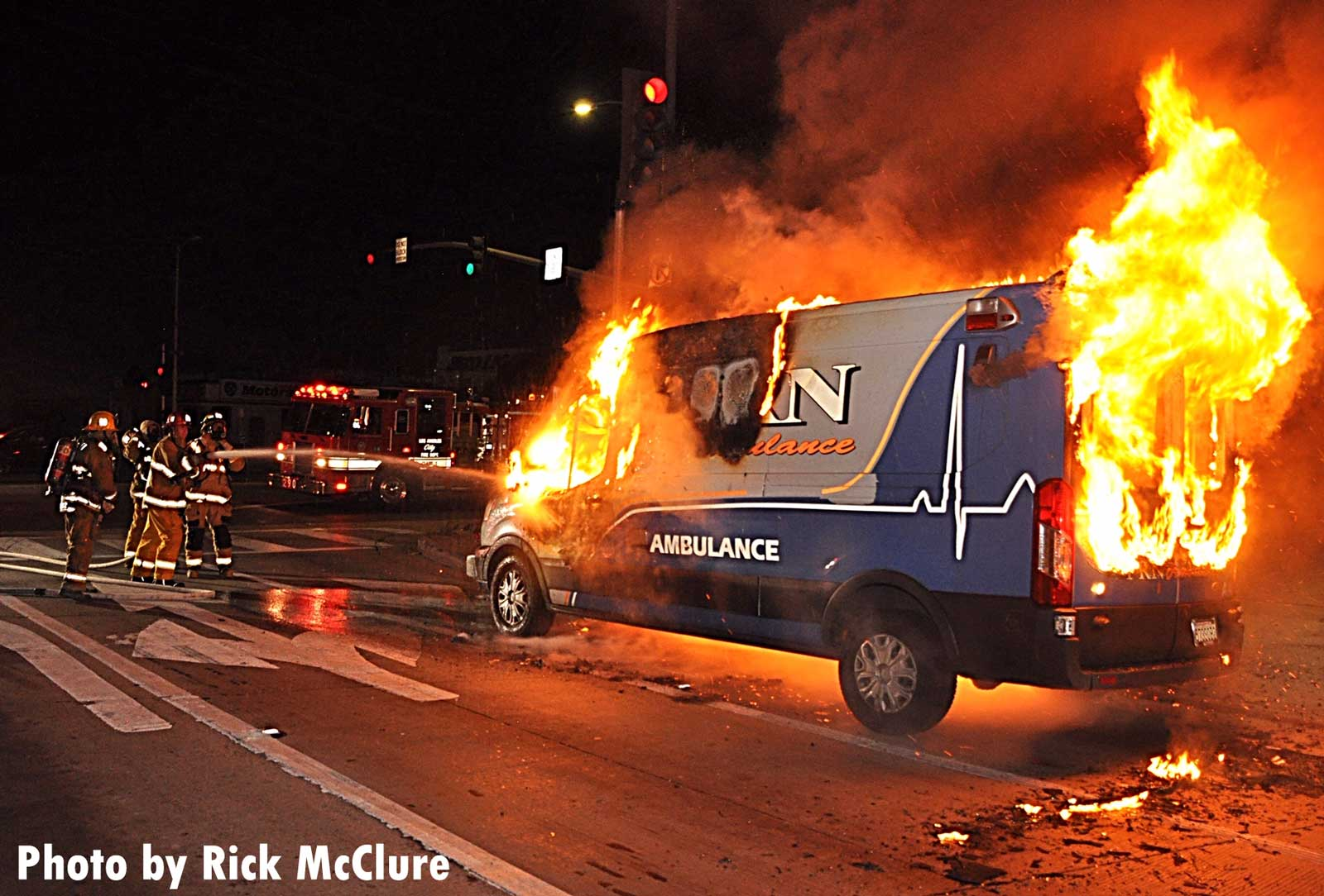 Firefighters get water on the ambulance fire