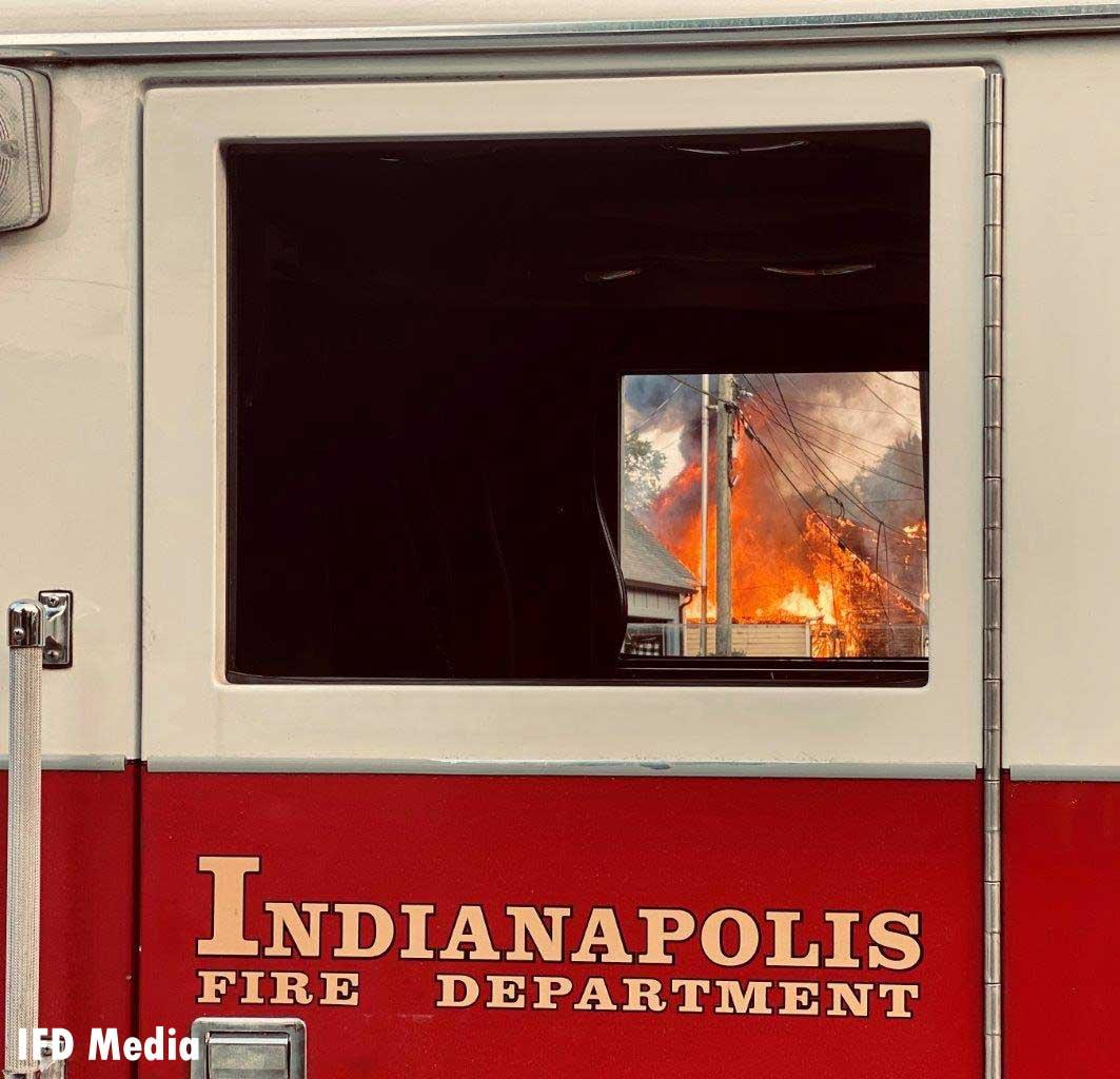 Flames seen through the window of a fire truck
