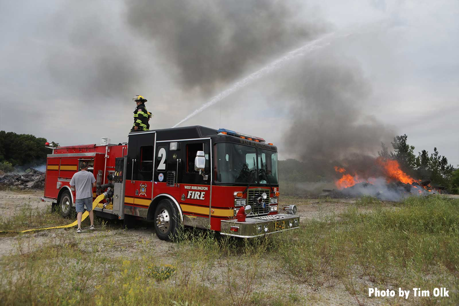 Firefighters use a master stream to put water on the fire